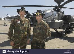 Us Army Cavalry Crew Of An Us Army Apache Anti Tank Combat Helicopter With