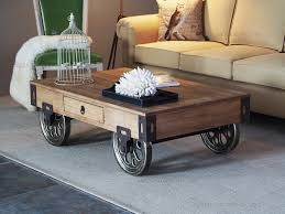 rustic-wood-coffee-table-with-wheels-on-grey-