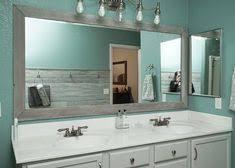 DIY Bathroom Mirror Frame for Under 10 Blue wood stain Mirror