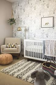 A neutral nursery in white, gray, and beige with a modern global theme -