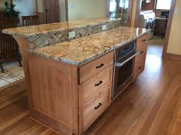 custom birch cabinet island with raised granite top by build it right