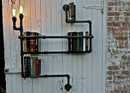 diy pipe lighting. pipe bookshelves by oilfield slang diy lighting