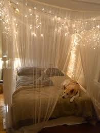 Create a magical cocoon around your bed with a gauzy and glittering canopy.  Simply hang