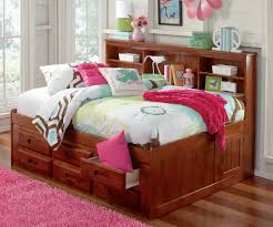 ... New Full Size Storage Bed With Bookcase Headboard Beautiful Comfortable  Pink And White Blanket And Pillows ...