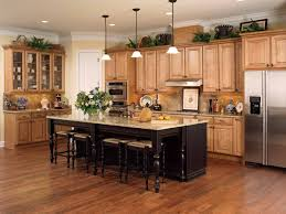 Picture Of Honey Colored Oak Cabinets With Dark Wood Floor And Black