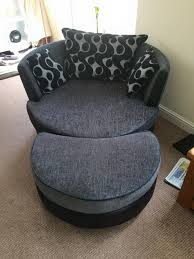double sofa bed and large round swivel cuddle chair and puffee