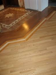 Types Of Floors For Kitchens Threshold Tile To Wood Floor In Open Concept Living Room And