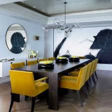 chic contemporary dining room with mustard yellow chairs