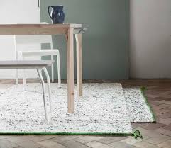 this has given the rug its birch tree look with a green band on one edge the small rug adds a personal touch and fits well in connection to a table or