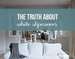 white slipcovered sofas
