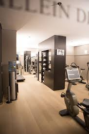 workout room with large windows that look out into the backyard/pool.....I  HATE driving to the Y, speaking to people at the Y, and having my TV con