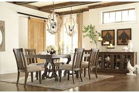 crafted with solid pine wood the wendota extension dining table set lets you have your fill of quality and vine inspired character