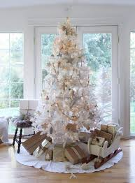 vintage white Christmas tree with wooden ornaments and lights