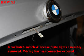 bmw x how to replace the rear hatch switch bmw x5 replacing the rear upper hatch switch wiring harness exposed