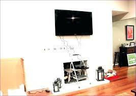 hide wires behind wall mounted brick in over fireplace tv without cutting wi