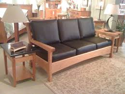 furniture black leather sofa with brown wooden legs and arms plus three seat added by