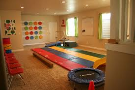 Interior Decoration:Colorful Kids Playroom With Small Grey Table Also Green  Cair On Brown Striped