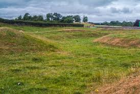 inside the earthwork ditch earthwork banks and ditches looking into the henge from the lane about king arthur s round table