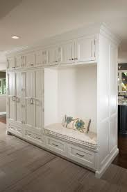 Traditional Entryway with High ceiling, Craftsman Panel Cabinet Door, Boxed  Bench Cushion - Natural