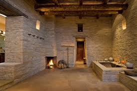 bathroom with tub and fireplace