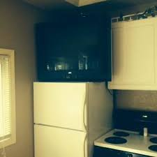 refrigerator with tv. arrowhead resort: kitchen with tv on top of refrigerator tv
