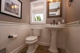 cottage powder room with pedestal sink high ceiling wainscoting 3 16 in