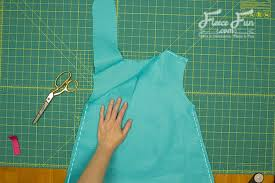 using a 25 inch seam allowance sew the sides bottom to bottom of armcye and at the the shoulder then sew on the front crossover piece