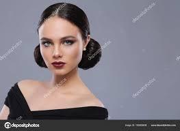 young beautiful woman fashion makeup black dress stock photo