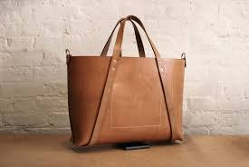 hand stitched leather bag in russet un