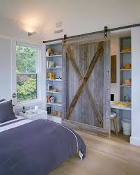 view in gallery reclaimed barn wood door for the bedroom shelf and office nook design hutker architects