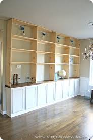 DIY built-ins bookcase with base cabinets from the big box store Upper  shelves are