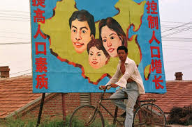 s one child policy propaganda posters over the years wsj a farmer rides past a billboard promoting s one child policy on the outskirts of