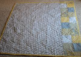 Yellow & gray diamond baby quilt & I didn't have enough of that gorgeous gray fabric to finish the back, so I  added two rows of patchwork squares with the same fabric as the front. Adamdwight.com