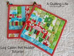 Log Cabin Pot Holder Tutorial | A Quilting Life - a quilt blog & I thought it would be fun to have a tutorial each Friday before  Christmas...I'll go back to my