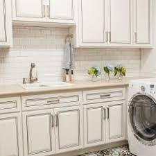 Lovely White Laundry Room With Subway Tile Backsplash