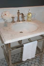 amazing bathroom with marble top washstand with newport brass 30 polished nickel amenities sink console with double wall returns and basket soho studio