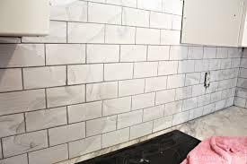 grouting the subway tile backsplash