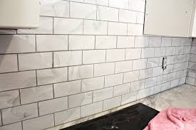 grouting the subway tile backsplash