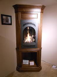 avalon hideaway portrait style gas fireplace in a walnut cabinet