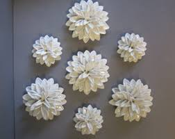 white ceramic flower wall art