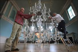 terry brotheridge and paul jones clean the chandeliers at bath s assembly rooms
