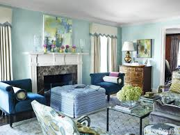 the celestial airiness of walls lacquered in benjamin moores antiguan sky is grounded by a pair best paint colors for office