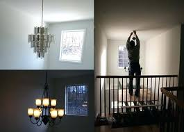 how low to hang a chandelier how low should chandelier hang in foyer painting stairs and how low to hang a chandelier