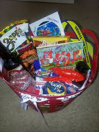 but this year i created a themed louisiana gift basket filled with all sorts of food goos from the state we live in i collected specialty items