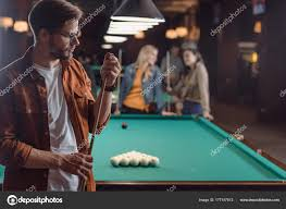 pool table bar. Young Man Chalking Cue Pool Table Bar Friends \u2014 Stock Photo