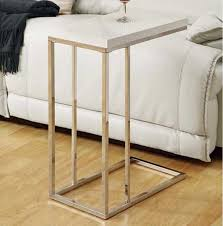 table under sofa. chrome metal side table under sofa