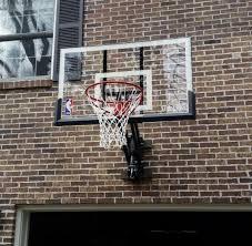 spalding 52 inch wall mount hoop on brick wall