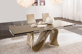 unique rectangular modern dining table with artwork base on white fur rugs and pendant lighting in beautiful white dining room decors