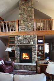 love this rock fireplace with the loft