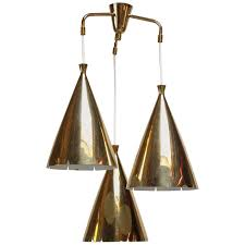 mid century three pendant solid brass chandelier after paavo tynell jarontiques
